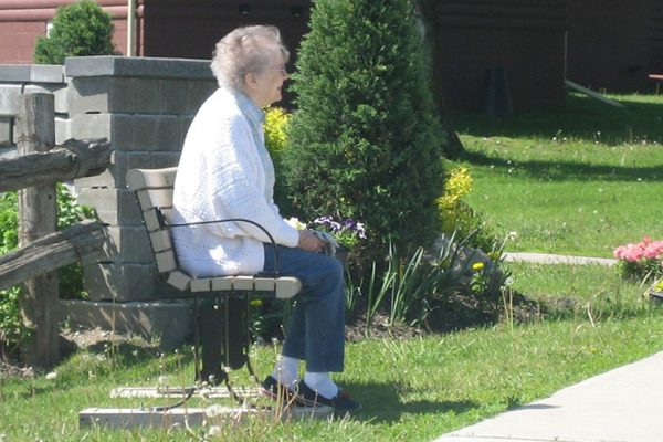 Resident outside on a bench